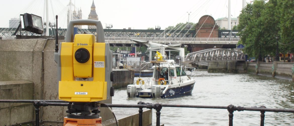 Trimble total station in use to check the accuracy of laser scanning on a boat